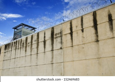 Prison wall and cloudy sky.