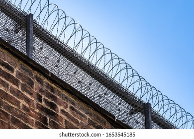 prison wall protected with barb wire