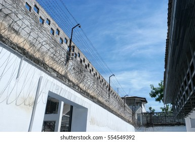the prison walls with high walls and barbed iron wire.
