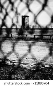 A prison watchtower viewed through wire fencing on Robben Island in Cape Town, South Africa