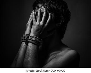 Prisoner with bound hands. Black and white.