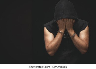prisoner concept,Handcuffed hand of a prisoner in prison, Male prisoners were severely strained in the dark prison, violence,