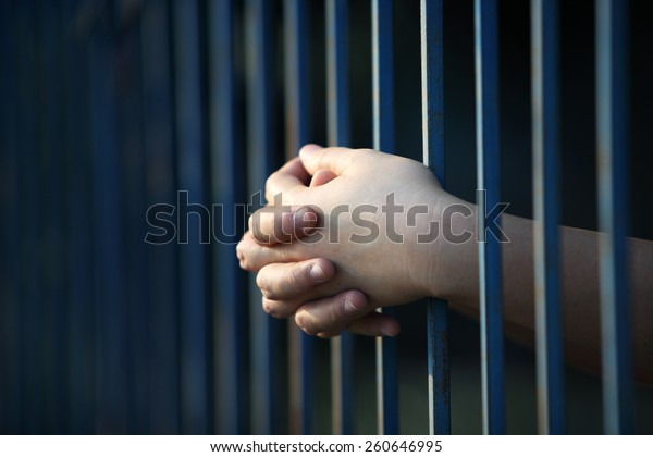 prisoner hand in jail