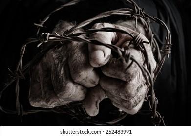Prisoner of war in barbed wire