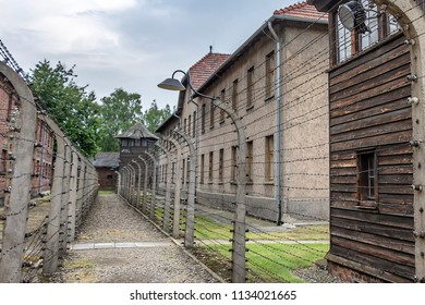 Prisoner's barrack in Auschwitz i with electric fence with barbed wire in concentration and extermination camp built and operated by Nazi Germany in German-occupied Poland by the Third Reich durin