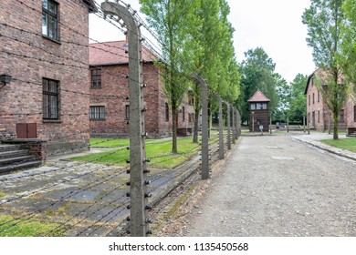 Prisoner's barrack in Auschwitz i with electric fence with barbed wire in concentration and extermination camp built and operated by Nazi Germany in German-occupied Poland by the Third Reich