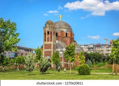 Pristina, Kosovo - May 30th 2018 - A huge orthodox church in a open grass field in Kosovo