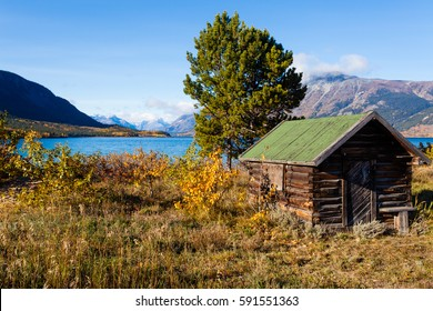 Pristine wilderness Landscape with historic wooden log building at shore of Lake Bennett near Carcross, Yukon Territory, Canada