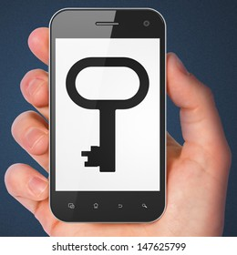 Privacy concept: hand holding smartphone with Key on display. Generic mobile smart phone in hand on Dark Blue background.