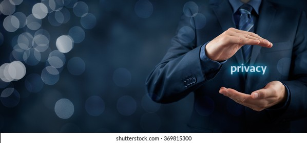 Privacy policy concept. Businessman with protective gesture and text privacy in hands. Wide banner composition with bokeh in background.