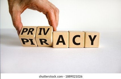 Privacy vs piracy symbol. Businessman hand turns cubes and changes the word 'piracy' to 'privacy'. Beautiful white background, copy space. Business and privacy vs piracy concept.