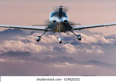 Privat Airplane flying above silhouette of high mountains at sunset. Travel concept and vacation background