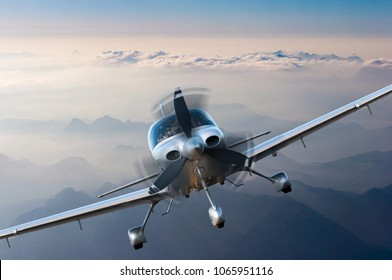 Privat light airplane or aircraft fly on mountain background. VIP travel concept