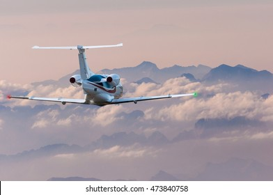 Privat plane or aircraft flight above mountains