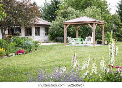 Private backyard living  surrounded with flower Garden and pergola for hot summer days. Relaxing, peaceful and  beautiful. Gazebo