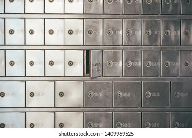 Private bank deposit box - close up of opened mailbox with a small key - post office box or PO BOX concept