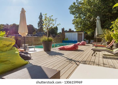 Private Bed and Breakfast  beautiful , swimming pool view from the veranda, Wooden table and chairs