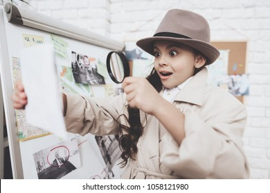 Private detective agency. Little girl in cloak and hat is looking at photos near clues board.