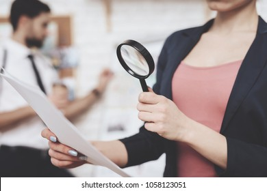 Private detective agency. Woman in jacket is posing with paper and magnifying glass, man is looking at clues map.
