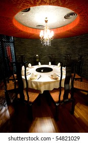 Private dining area in a high-class Chinese restaurant with traditional Asian decor