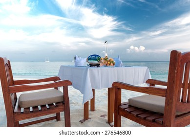 private dinner at a beach on the maldives