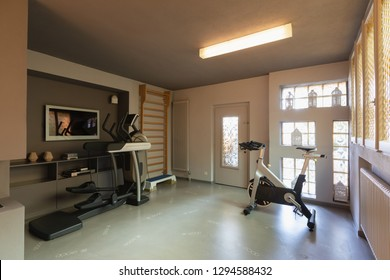 Private gym with exercise bikes, treadmills and espalier for exercises. Nobody inside