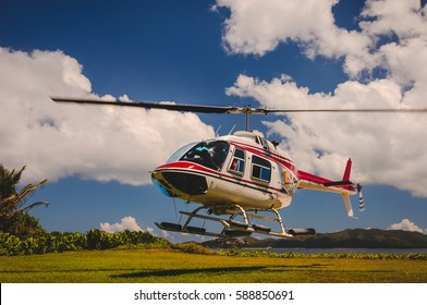 private helicopter landing on a tropical island