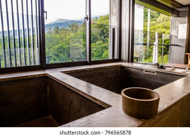 The private hot and cold spring tub with a wooden bucket and a scenic view in the Grand View Resort Beitou, Taipei, Taiwan. Taken in September 2014.