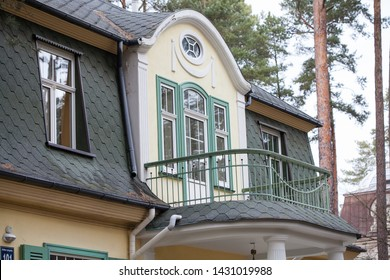 Private house in calm Jurmala. Balcony in classic home surrounded with pine trees. Green rooftop.