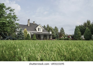 A private house and its garden under blue sky