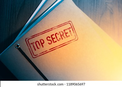 Private investigator desk with top secret envelopes