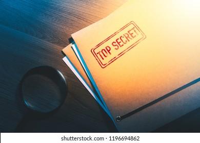 Private investigator desk with top secret envelopes