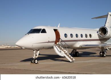 Private Jet Airplane A private jet airplane waiting for passengers. Horizontal.