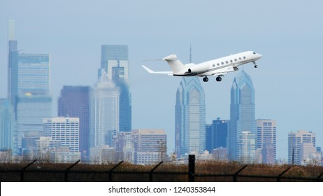 A Private Jet Flying in Front of the Philadelphia Skyline