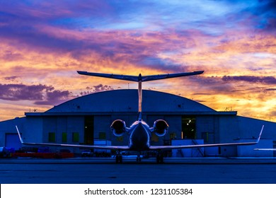 Private jet in front of a hangar.