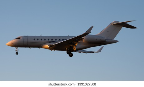 Private Jet Landing, Illuminated by the Sunset