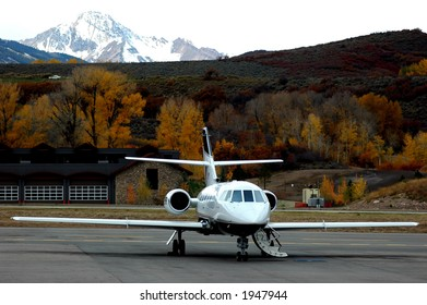 private jet on tarmac ready for passenger boarding