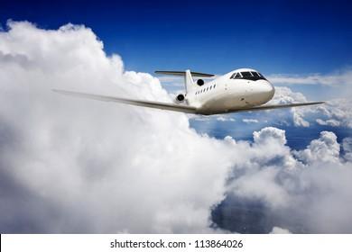 Private jet plane in the blue sky.