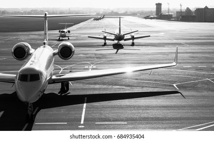 Private jet planes  on the landing line.Black and white.