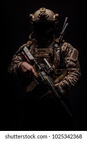 private military contractor holding rifle. Image on a black background. war, army, weapon, technology and people concept