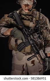 private military contractor holding sniper rifle. war, army, weapon, technology and people concept. Image on a black background.