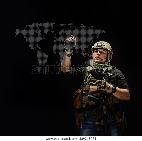 private military contractor with rifle writing on blank glass board or virtual screen with red marker .People and military concept. Image on a black background.