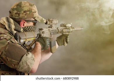 private military contractor shooting a carbine