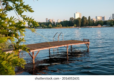 """Private Pier at the """"Alte Donau"""" (Old Danube) in Vienna. VIC with  United Nations Office in Background. Sunny Summer day. - Shutterstock ID 2016052631"""
