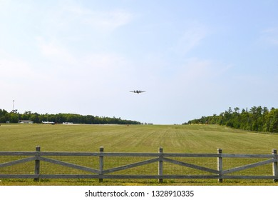 A private plane rises from the Mackinac island airport