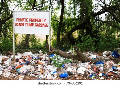 Private property. Do not dump garbage. Garbage waste dumping site. Plastic garbage pollution. Bottles and bags pollute the environment. Dumping area. Garbage at the dump.