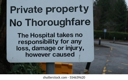 Private Property and no thoroughfare sign in england white with black font