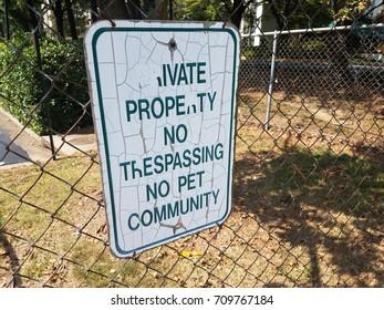 private property no trespassing no pet community sign