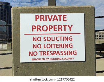 Private Property Sign: No Soliciting, No Loitering, No Trespassing - Enforced by Building Security