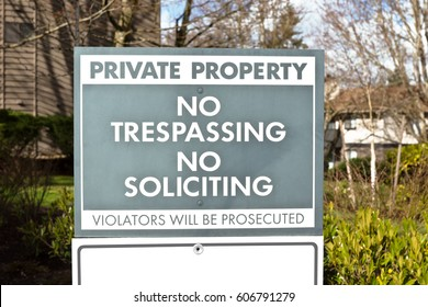 Private Property sign with no trespassing and no soliciting in a residential community.